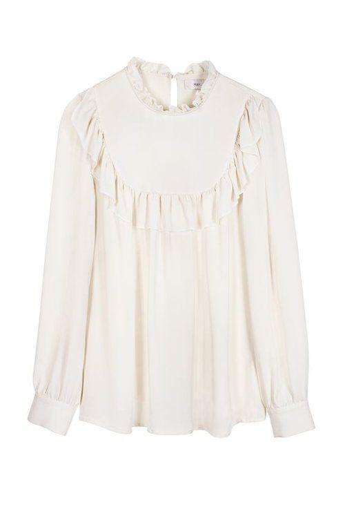 Victorias vita blus och vita jacka
